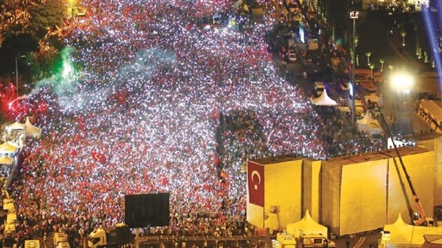 Millions gather near Istanbul's Martyrs Bridge to make the first anniversary of the failed coup attempt