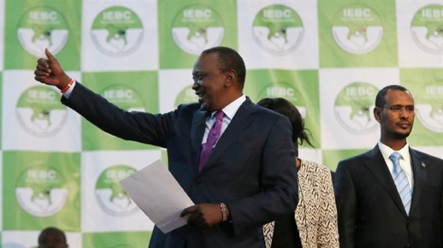 Incumbent President Uhuru Kenyatta reacts after he was announced winner of the presidential election at the IEBC National Tallying centre at the Bomas of Kenya, in Nairobi, Kenya August 11, 2017.
