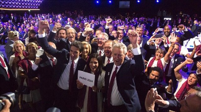 Mayor of Paris Anne Hidalgo and delegates from Paris 2024 celebrate after IOC President Thomas Bach announced the winners of the Olympic Games of 2024 and 2028 during the 131st International Olympic Committee Session at the Lima Convention Center in Lima, Peru