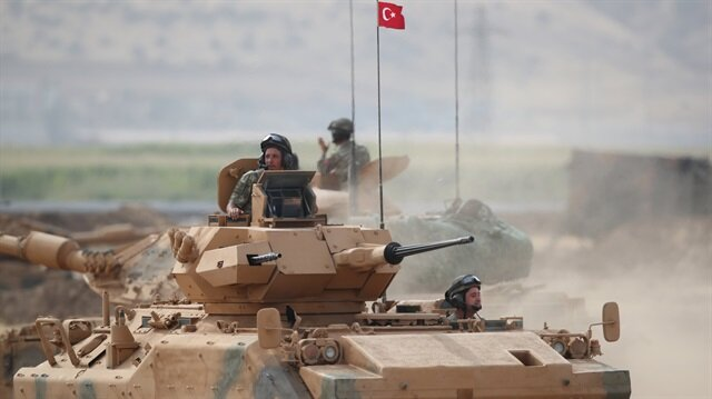 A Turkish tank maneuvers during a military exercise near the Turkish-Iraqi border.