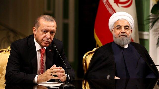 Recep Tayyip Erdogan (L) and Hassan Rouhani (R)