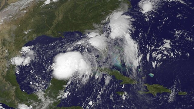 Two Tropical Depressions are shown over the Gulf of Mexico