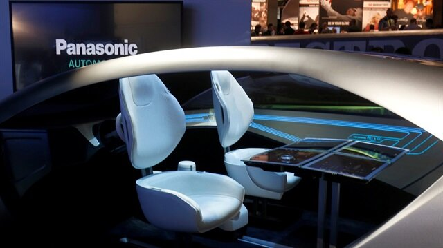 A mock-up of an autonomous car interior is shown at the Panasonic booth