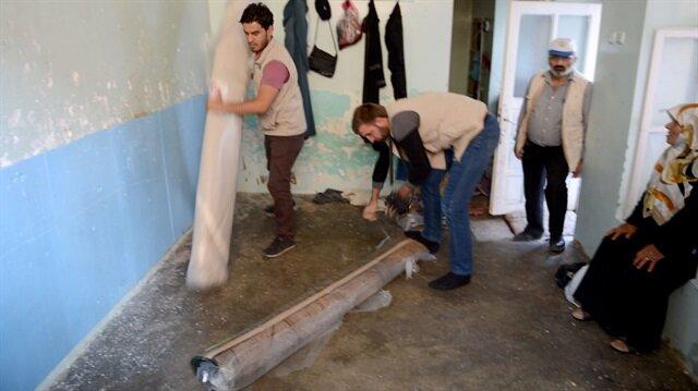 Suriyeli ailelere halı yardımı