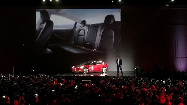 esla Chief Executive Elon Musk introduces one of the first Model 3 cars