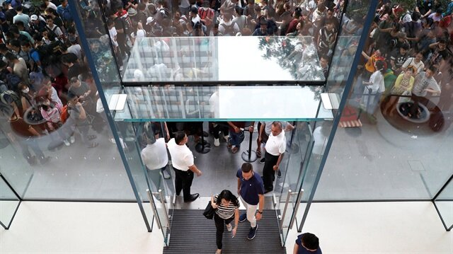 People queue to buy iPhone X during its launch at an Apple store.