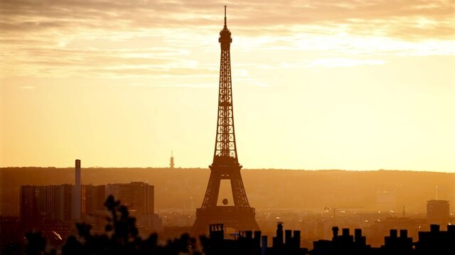 The Eiffel Tower is seen at sunset in Paris, France