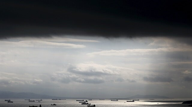 File photo of cargo ships seen sailing under storm clouds in the sea near Greece