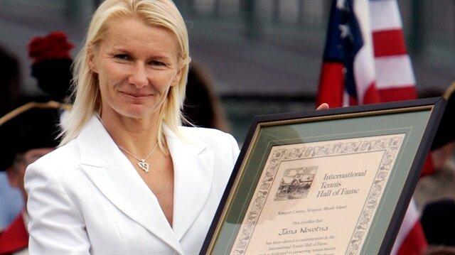 File Photo: Jana Novotna holds up International Tennis Hall of Fame certificate in Newport