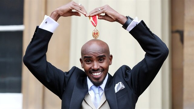Mo Farah poses after he received his knighthood from Britain's Queen Elizabeth at Buckingham Palace, London