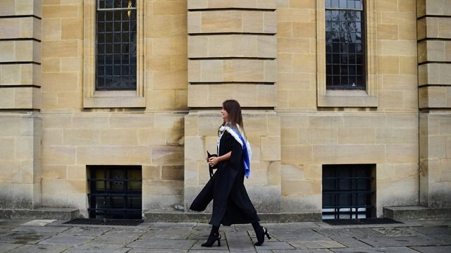A graduate walks away after a graduation ceremony at Oxford University, in Oxford, Britain July 15, 2017.