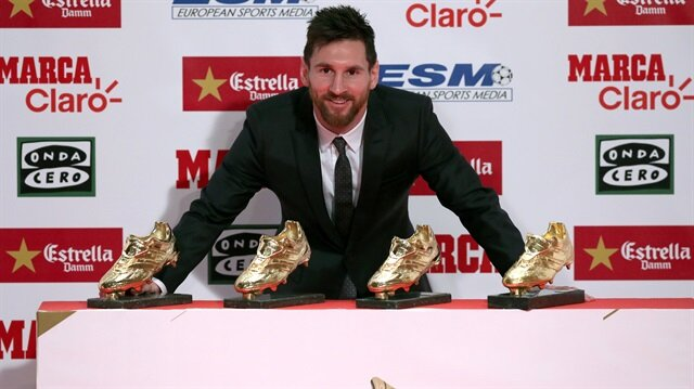 Barcelona's Lionel Messi poses with his four Golden Boot trophies during a ceremony in Barcelona