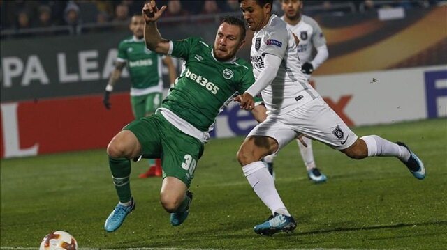 Mossoro (R) of Medipol Basaksehir in action against Cosmin Moti (30) of Ludogorets during the UEFA Europa League Group C soccer match between Ludogorets and Medipol Basaksehir at Ludogorets Arena in Razgrad, Bulgaria