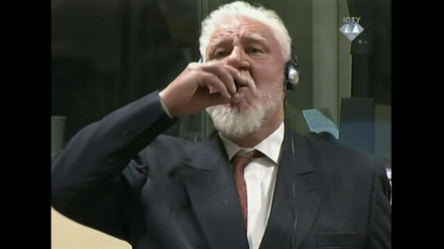 War crimes accused takes 'poison' in Hague dock