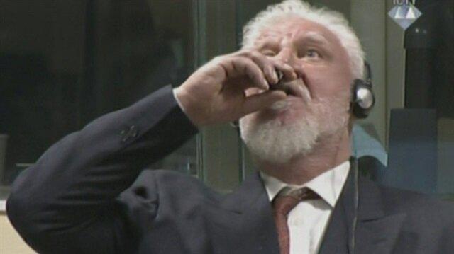 İşkenceci eski Hırvat General Praljak, 20 yıl ceza aldığı duruşmada zehir içti.