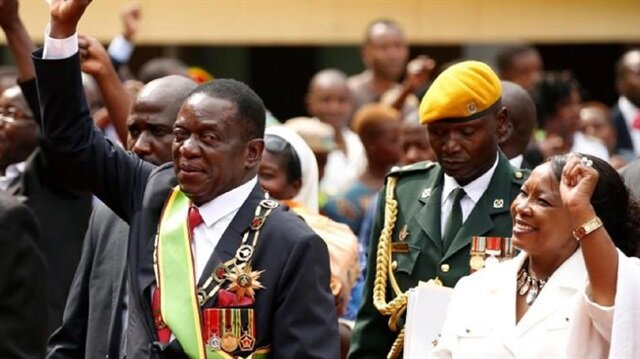 Zimbabwe's new president Emmerson Mnangagwa and his wife Auxillia wave to their suppoters as they leave after the swearing in ceremony in Harare, Zimbabwe
