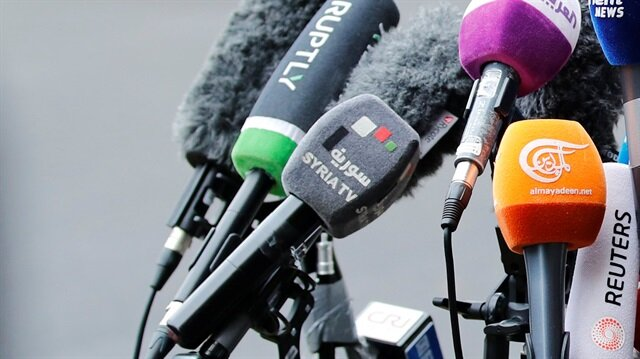 Microphones from television networks are pictured