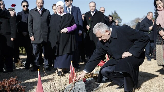 Prime Minister of Turkey Binali Yıldırım and his wife Semiha Yıldırım (L) visit UN Memorial Cemetery in Busan which honors 462 Turkish martyrs of Korean War, in South Korea on December 5, 2017.