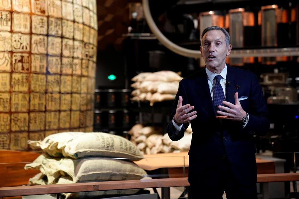 Starbucks executive chairman Howard Schultz attends a press conference at the new Starbucks Reserve Roastery in Shanghai