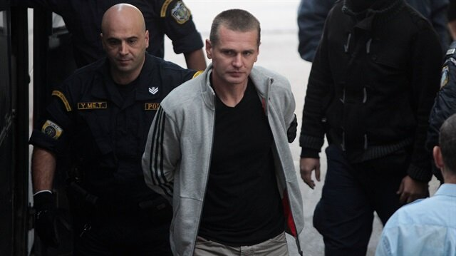 Alexander Vinnik, a 38 year old Russian man (C) suspected of running a money laundering operation using bitcoin, is escorted by police officers to a court in Thessaloniki, Greece.