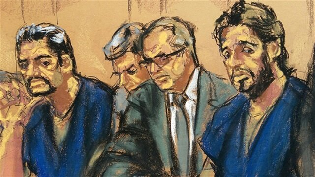 Turkish gold trader Reza Zarrab (2nd R) sits with lawyers Erich Ferrari (L), Marc Agnifilo, and Benjamin Brafman (R) as he appears in Manhattan federal court in New York, U.S.