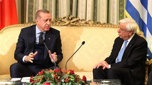 Turkish President Recep Tayyip Erdoğan (L) and his Greek counterpart Prokopis Pavlopoulos