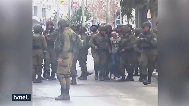 Footage emerges of 22 Israeli soldiers arresting 14-year-old Palestinian boy