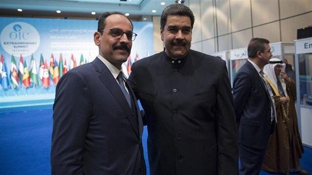 Turkish Presidential spokesman İbrahim Kalın (L) and Venezuelan President Nicholas Maduro (R)