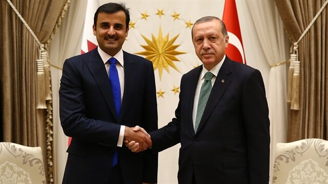 President of Turkey, Recep Tayyip Erdoğan (R) shakes hands with Qatari Sheikh Tamim bin Hamad Al Thani (L) at Presidential Complex in Ankara, Turkey.
