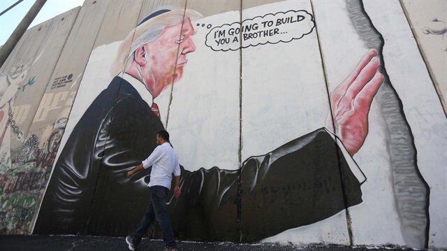 ABD Başkanı Trump'ın graffiti çalışması Filistin'deki duvarlarında