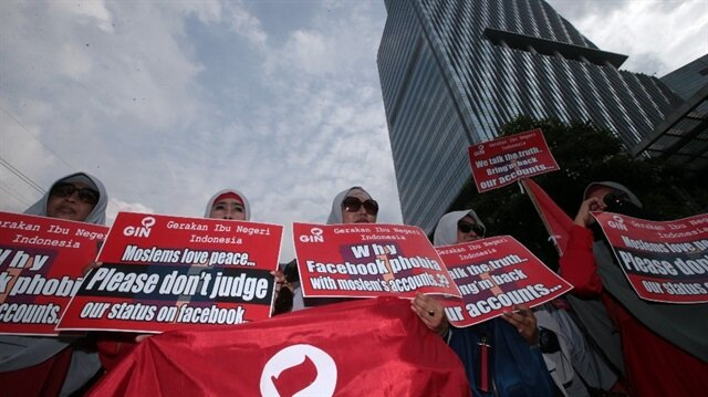 Protesters rally outside the local Facebook office in Jakarta, Indonesia