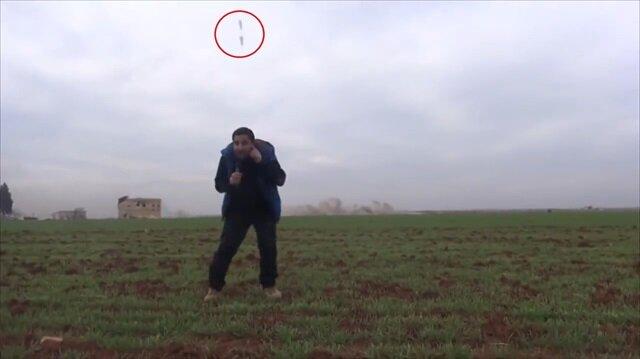 İnanılmaz görüntü: Muhabirin yanına düşen bomba kamerada!