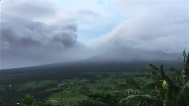 Philippines raises volcano alert level as eruptions spew ash