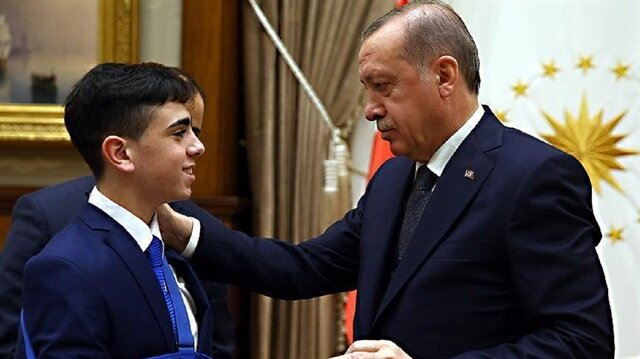 Palestinian boy Juneidi meets Turkish family minister