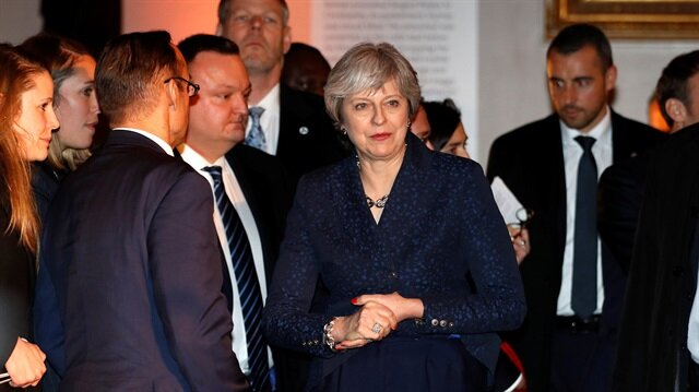 British PM May says will stop companies abusing pension schemes