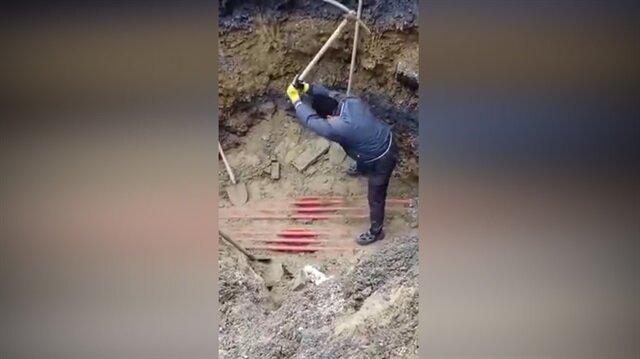Yüksek gerilim hattına kazma vuran işçiye bakın ne oldu?