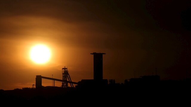File Photo: The sun sets behind a shaft outside the mining town of Carletonville, west of Johannesburg, July 7 2015