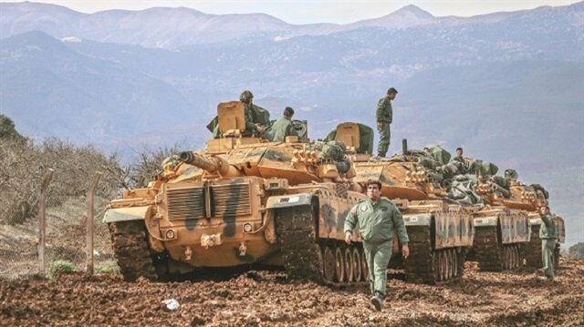 Syrian government fighters enter Kurdish enclave amid Turkish threats