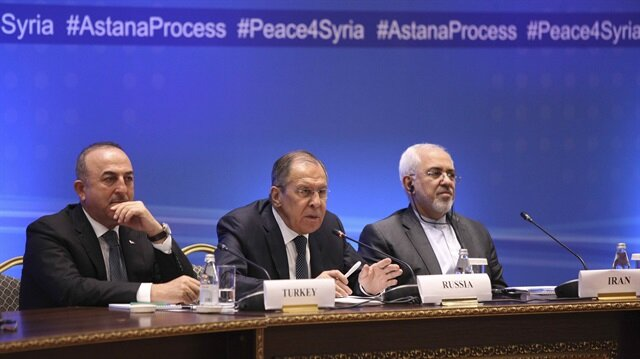 Foreign Ministers, Sergei Lavrov (C) of Russia, Mevlüt Çavuşoğlu (L) of Turkey and Mohammad Javad Zarif of Iran, attend the international meeting on Syria in Astana, Kazakhstan March 16, 2018.