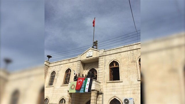 TAF, FSA hoist Turkish, Syrian flags over public buildings in Afrin