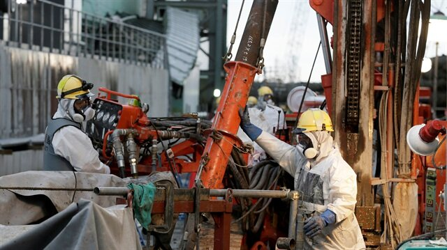 File Photo: Workers prepare frozen pipes during operations to construct an underground ice wall at Tokyo Electric Power Co.'s (Tepco) tsunami-crippled Fukushima Daiichi nuclear power plant in Fukushima Prefecture July 9, 2014.