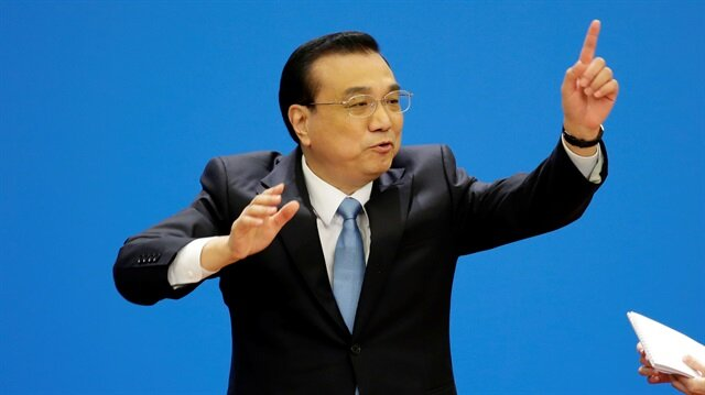 China's premier hopes trade war can be averted, pledges more open economy