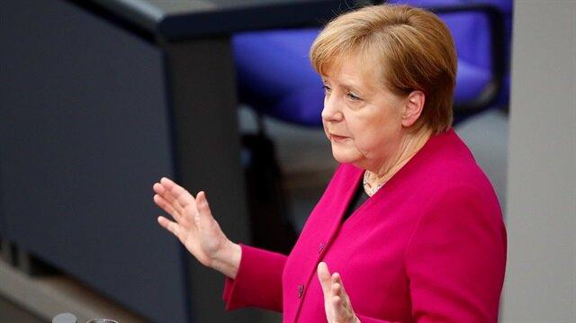 Merkel slams Trump's import tariffs as 'unlawful'