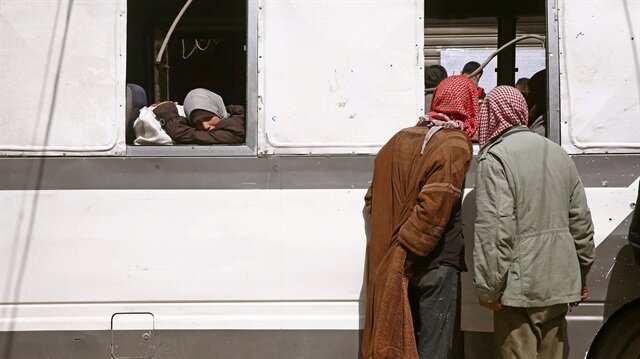 Civilians flood out of Syria's Douma