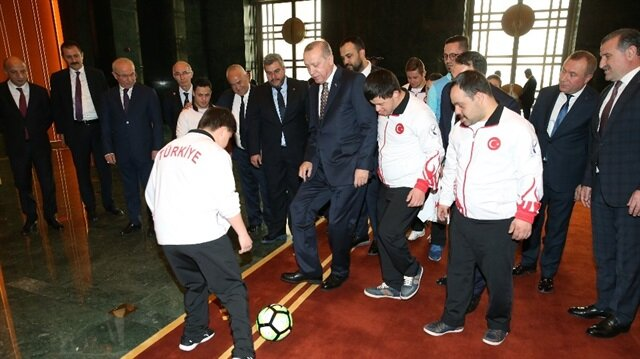 Erdoğan receives Turkey's Down syndrome athletes in presidential complex
