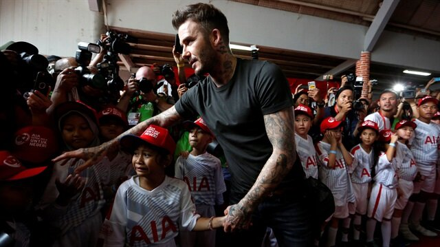 David beckham tackles bullying and violence in indonesian schools girls hand while greeting young soccer players at a crowded aia insurance charity event to encourage and assist young indonesian soccer players around m4hsunfo