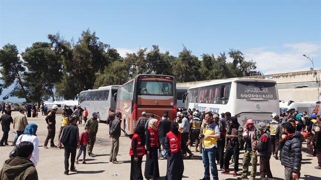 Last rebel group starts leaving Syria's Eastern Ghouta: state media