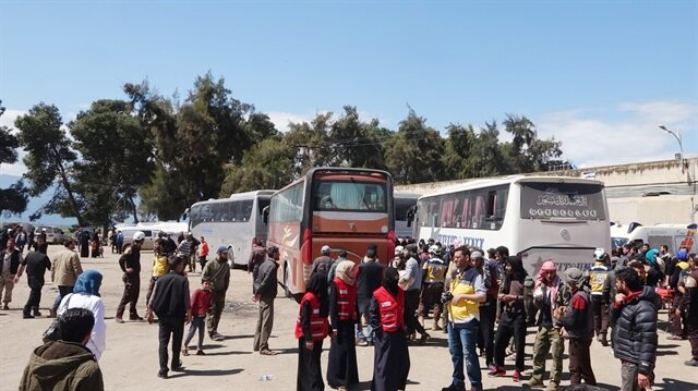 Buses in Syria's Eastern Ghouta for more evacuations
