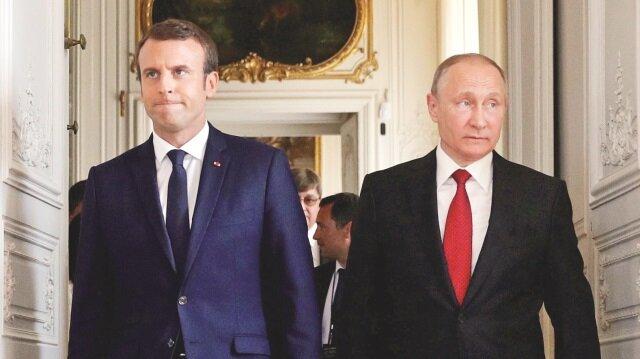 Putin Macron'u uyardı: Londra'nın parmağı var