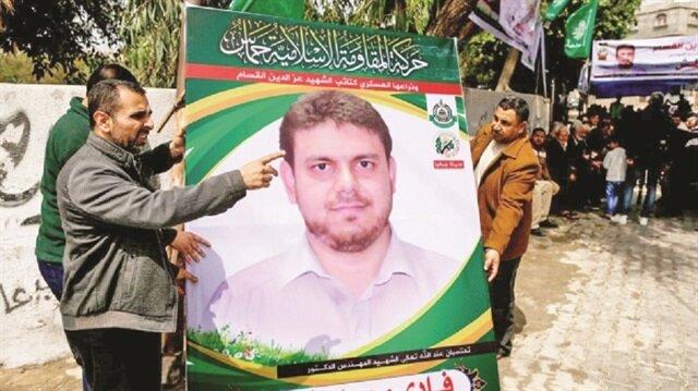 Slain Palestinian lecturer buried in Gaza